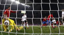 Spain's Carles Puyol celebrates after scoring against Germany\ (MARCOS BRINDICCI/REUTERS)