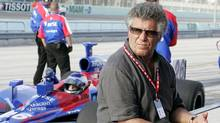 Legendary race car driver and now car-owner Mario Andretti watches his team's car run practice laps for the XM Satellite Radio Indy 300 auto race in 2007, in Homestead, Fla. (Terry Renna/Terry Renna/AP Photo)