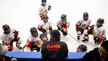 Minor Pee Wee AA players from the Leaside Flames listen to their coach during a GTHL hockey game at St. Michael's arena on Sept. 30, 2011. (Della Rollins For The Globe and Mail)