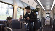 A passenger has her ticket scanned on a Union Pearson Express train in June. Ridership is off to disappointing start. (Michelle Siu/The Canadian Press)