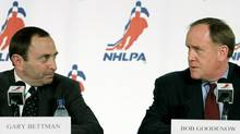 National Hockey League (NHL) commissioner Gary Bettman (L) and NHLPA Executive Director Bob Goodenow look at each other during a news conference announcing a new collective bargaining agreement and an end to the lockout between the players and the league in Toronto, July 21, 2005. (J.P. MOCZULSKI/REUTERS)