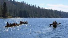 Members of the Sea to the Source expedition canoe up the Columbia River. (Handout)
