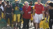 Toronto Mayor Rob Ford, in red, walks off the field after coaching football at Don Bosco Catholic Secondary School on Sept. 12, 2012. (MATTHEW SHERWOOD/THE GLOBE AND MAIL)