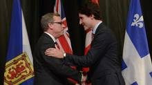 Prime Minister Justin Trudeau welcomes Saskatchewan Premier Brad Wall to the First Ministers meeting at the Canadian Museum of Nature in Ottawa on Monday, Nov. 23, 2015. (Adrian Wyld/THE CANADIAN PRESS)