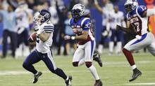 Toronto Argonauts Chad Owens runs after a long reception past Montreal Alouettes Dwight Anderson (C) and Billy Parker (R) during the second half of the CFL's Eastern Conference Final football game in Montreal, November 18, 2012. (MATHIEU BELANGER/REUTERS)