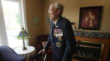 George Peterson, 94, a World War 2 veteran who served at the Battle of Hong Kong, is photographed in his Winnipeg home. Mr Peterson was captured by the Japanese during that battle and forced, as a prisoner of war, to work in a Mitsubishi coal mine for over three years. (JOHN WOODS/GLOBE AND MAIL)