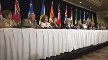 From left to right, premiers Eva Aariak, Bob McLeod, Alison Redford, Robert Ghiz, Greg Selinger, Darrell Dexter, Kathleen Wynne, Pauline Marois, David Alward, Christy Clark, Brad Wall, Kathy Dunderdale, and Darrell Pasloski take part in the closing news conference on the final day of the Council of the Federation summer meeting in Niagara-on-the-Lake, Ont., Friday, July 26, 2013. (Aaron Lynett/THE CANADIAN PRESS)