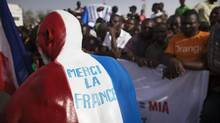 "French forces have liberated the people of Mali from oppressive Islamist rule. REFILE - CORRECTING IPTC CREDIT A Malian man painted in the colours of the French flag and with the words reading: ""Thank you France"" stands next to a crowd before the arrival of France's President Francois Hollande at the Independence Plaza in Bamako, Mali February 2, 2013. France will withdraw its troops from Mali once the Sahel state has restored sovereignty over its national territory and a U.N.-backed African military force can take over from the French soldiers, Hollande said on Saturday. REUTERS/Joe Penney (MALI - Tags: POLITICS CONFLICT TPX IMAGES OF THE DAY) (JOE PENNEY/REUTERS)"