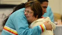 Attawapiskat Chief Theresa Spence is hugged by one of her many helpers during a celebration to end her hunger strike in Ottawa on Thursday, Jan. 24, 2013. (Sean Kilpatrick/THE CANADIAN PRESS)