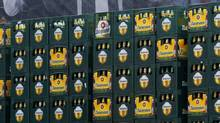 A beer advertisement poster is seen behind crates containing bottles waiting to be filled with Zlatopramen radler beer in Krusovice Brewery, west of Prague. (PETR JOSEK/REUTERS)
