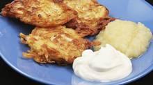 Potato latkes served with sour cream and applesauce. (iStockphoto/iStockphoto)