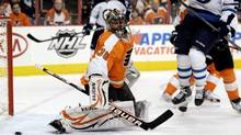 Philadelphia Flyers goalie Ilya Bryzgalov (30), of Russia, follows the puck as Winnipeg Jets' Andrew Ladd (16) jumps out of the way during the first period of an NHL hockey game, Tuesday, Jan. 31, 2012, in Philadelphia. (TOM MIHALEK/AP)