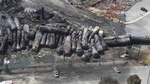 An aerial view of burnt train cars after a train derailment and explosion in Lac-Megantic, Quebec July 8, 2013. The Transportation Safety Board will release a report on the derailment later this month. (TRANSPORTATION SAFETY BOARD/REUTERS)