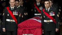 Members of The Royal Canadian Regiment carry the casket at the funeral for Warrant Office Michael Robert McNeil at the Truro Armouries in Truro, N.S. on Thursday, Dec. 5, 2013. McNeil completed several tours of duty including Afghanistan, Bosnia and Croatia. McNeil took his own life in late November at CFB Petawawa. (Andrew Vaughan/THE CANADIAN PRESS)