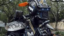 "The third feature from director Neill Blomkamp is set in a gang-infested Johannesburg of the near future, where the police employ thousands of ""scout"" robots on the streets. (Courtesy of Columbia Pictures)"