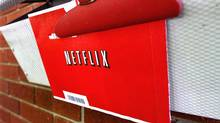 In this Thursday, Aug. 23, 2012, photo, a Netflix envelop containing a DVD to be returned by mail is clipped onto a mailbox, in Springfield, Ill. (Seth Perlman/AP)