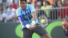 Milos Raonic, of Canada, returns the ball during the Sony Open Tennis in Key Biscayne, Fl., Saturday, March 22, 2014. (J Pat Carter/AP)