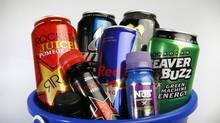 As the popularity of both energy shots and the larger-sized energy drinks grows, governments are grappling with how to regulate their sale. Some experts worry about news reports that teenagers are mixing alcohol with the larger-sized drinks, such as Red Bull, and fear those who use the smaller shots may not be aware of how much caffeine they are consuming at once. (DEBORAH BAIC/THE GLOBE AND MAIL)
