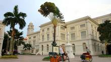 Colonial architecture and trishaw transport are reminders of Singapore's past. (Singapore Tourism Board)