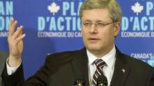 Prime Minister Stephen Harper holds a news conference at a paper plant in Windsor, Que., on Jan. 6, 2011. (Graham Hughes/THE CANADIAN PRESS)