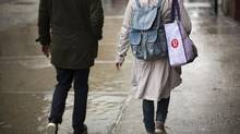 A woman carries a shopping bag with the Lululemon Athletica Inc logo outside one of the company's stores in New York, March 19, 2013. The Taiwanese supplier behind the see-through yoga pants recalled by Lululemon Athletica Inc said on Tuesday it followed design specifications and the Canadian retailer had merely misjudged customer tastes. (LUCAS JACKSON/REUTERS)