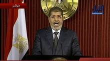 Egyptian President Mohammed Morsi delivers a televised statement in Cairo on Thursday. (NILE TV/ASSOCIATED PRESS)