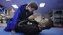 Sports reporter Darren Yourk, top. takes part in some mixed martial arts training with Firas Zahabi, at the Toronto Kickboxing and Muay Thai Academy. Zahabi trains UFC welterweight champion Georges St-Pierre. (Fred Lum/The Globe and Mail)