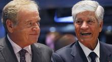 Omnicom Group chief executive John Wren, left, and Publicis Groupe SA chairman and CEO Maurice Levy smile after announcing an agreement on their merger on the floor of the New York Stock Exchange on July 29, 2013. (SHANNON STAPLETON/REUTERS)