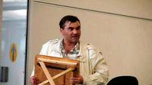 FILE -- Robert Dziekanski holds a small table at the Vancouver Airport in this image from video.The final hours of Dziekanski's life, from when he boarded a plane in Poland to when he lay writhing on the floor of Vancouver's airport after being stunned by an RCMP Taser, will be recounted by dozens of witnesses at a public inquiry beginning Monday. THE CANADIAN PRESS/HO-Paul Pritchard (Paul Pritchard/The Canadian Press)