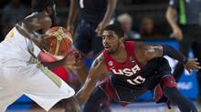 Kyrie Irving of the US tries to block Ukraine's Eugene 'Pooh' Jeter (Alvaro Barrientos/AP)