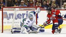 Vancouver Canucks goalie Ryan Miller (30) makes a save on Washington Capitals right wing Tom Wilson (43) in the second period at Verizon Center in Washington D.C., on Thursday, Jan. 14, 2016. The Capitals won 4-1. (Geoff Burke/USA Today Sports)