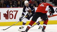 Atlanta Thrashers' Ilya Kovalchuk (L) lines up his shot as Ottawa Senators' Chris Phillips plays defense during the second period of their NHL hockey game in Ottawa October 10, 2009. REUTERS/Blair Gable (CANADA SPORT ICE HOCKEY) (BLAIR GABLE)