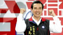Taiwan's re-elected President Ma Ying-jeou gestures as he celebrates winning the 2012 presidential election with supporters in Taipei Jan. 15, 2012. (Pichi Chuang/Reuters/Pichi Chuang/Reuters)