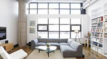The hard lofts at 90 Sumach were created in the 1990s by converting a former warehouse from the 1950s that was once used by the CBC for rehearsal space. This unit has 14-foot high ceilings in the main space, that has a fall of north-facing windows.