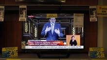 Spain's Prime Minister Mariano Rajoy, shown on a television screen at an electronics store in Malaga, delivers his answering speech during the State of the Nation debate in Madrid. (JON NAZCA/REUTERS)