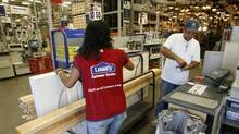 The number of new homes available for sale in the United States remains near record lows. That means builders will likely have to start construction on more homes to keep up with demand. Here, Francisco Ruano of Slymar, Calif., purchases a door and lumber at a Lowe's store in Burbank. (FRED PROUSER/REUTERS)