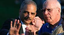 U.S. Attorney-General Eric Holder, left, and Chairman of the Senate Judiciary Committee Patrick Leahy talk on the South Lawn of the White House on Wednesday. (Larry Downing/Reuters)