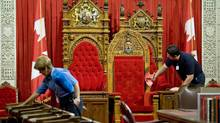 Cleaning staff prepare the Senate for the next session, which begins Sept. 14 amid heightened threat of a snap election. (Adrian Wyld/The Canadian Press)