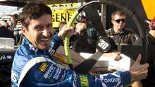 Alex Tagliani jokes with his crew at the Circuit Gilles Villeneuve in Montreal in this 2012 file photo. (Ryan Remiorz/THE CANADIAN PRESS)