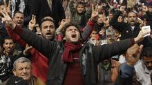 Anti-Gaddafi protesters chant slogans during a protest in Benghazi February 25, 2011. (SUHAIB SALEM/REUTERS/Suhaib Salem)