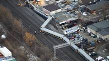 Emergency crews attend the scene where a VIA train was derailed with passengers on board in Burlington, Ont. (Nathan Denette/Nathan Denette/CP)