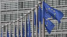 EU flags fly at the European Commission headquarters in Brussels, Monday, May 9, 2011. (Yves Logghe/AP)