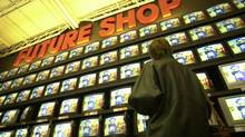 A wall of televisions at a Future Shop store in 2002. (Fred Lum/The Globe and Mail)