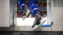 A member of the Vancouver Canucks steps on the ice for practice at Rogers Arena October 5, 2011 in Vancouver, BC. (Jeff Vinnick For The Globe and Mail)