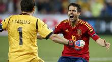 Spain's Cesc Fabregas celebrates with goalkeeper Iker Casillas after scoring the winning penalty goal against Portugal during the penalty shoot-out in their Euro 2012 semi-final soccer match at the Donbass Arena in Donetsk, June 27, 2012. (JUAN MEDINA/REUTERS)