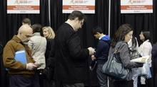 People are seen at a job fair in Toronto in April, 2014. Canada's employment count ended 2014 with back-to-back monthly declines, but beneath the surface of the stalled job numbers is evidence of an improving quality in the country's labour market. (Aaron Harris/REUTERS)