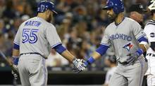 Jose Bautista #19 of the Toronto Blue Jays is congratulated by Russell Martin #55 of the Toronto Blue Jays after hitting a solo home run against the Detroit Tigers during the seventh inning at Comerica Park on July 14, 2017 in Detroit, Michigan. (Duane Burleson/Getty Images)