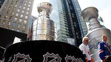 NHL's Stanley Cup and a replica of the trophy as it sits on display in Times Square in New York, April 11, 2012 (REUTERS/Gary Hershorn)