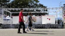 Merchants at the Richmond, B.C., Night Market walk past a temporary stage used for performances at the market, July 29, 2011. (RIchard Lam/Globe and Mail/RIchard Lam/Globe and Mail)