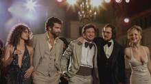 "This film image released by Sony Pictures shows, from left, Amy Adams, as Sydney Prosser, Bradley Cooper, as Richie Dimaso , Jeremy Renner, as Mayor Carmine Polito, Christian Bale as Irving Rosenfeld, and Jennifer Lawrence as Rosalyn Rosenfeld, in a scene from ""American Hustle."" (Francois Duhamel/AP)"